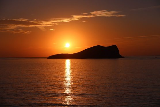 See a sunset in Ibiza with kids